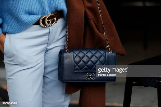 A guest wearing Gucci belt and Chanel clutch during MercedesBenz Fashion Week Weekend Edition 2018 at Carriageworks on May 19 2018 in Sydney Australia
