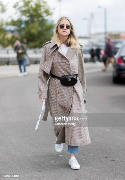 A guest wearing Gucci belt bag outside Versus Versace during London Fashion Week September 2017 on September 17 2017 in London England