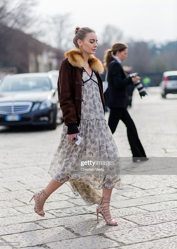 4fff64cb2c8 A guest wearing Gucci jacket and a floral dress and sandals seen ...