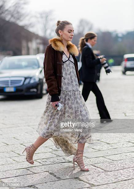 A guest wearing Gucci jacket and a floral dress and sandals seen outside Gucci during Milan Fashion Week Fall/Winter 2016/17 on February 24 2016 in...