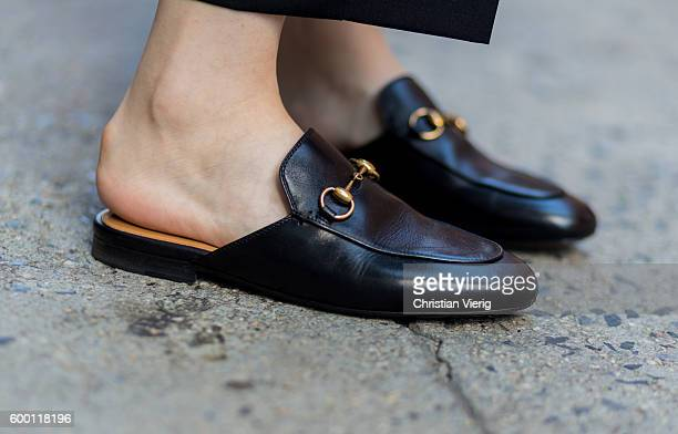A guest wearing Gucci slip on shoes outside Parsons on September 7 2016 in New York City