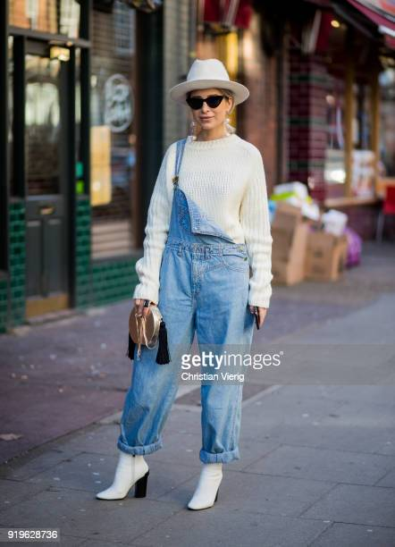 A guest wearing hat creme white knit denim overall silver round bag seen outside JW Anderson during London Fashion Week February 2018 on February 17...