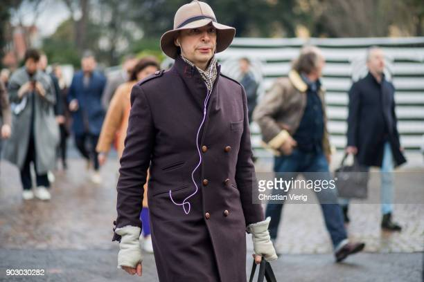 A guest wearing hat wool coat gloves is seen during the 93 Pitti Immagine Uomo at Fortezza Da Basso on January 9 2018 in Florence Italy