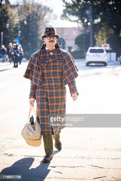 Guest wearing havelock coat is seen at Fortezza Da Basso on January 08 2020 in Florence Italy