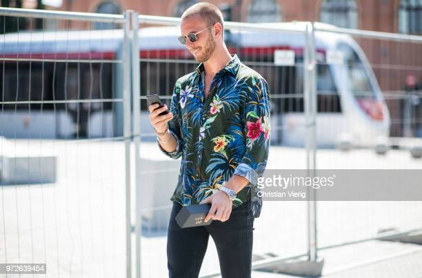 A guest wearing hawai button shirt with floral print is seen during the 94th Pitti Immagine Uomo on June 12 2018 in Florence Italy