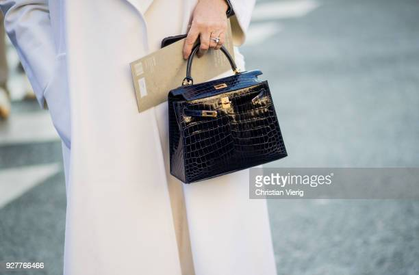 A guest wearing Hermes bag is seen outside Stella McCartney during Paris Fashion Week Womenswear Fall/Winter 2018/2019 on March 5 2018 in Paris France