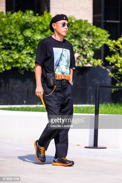 Guest wearing Heron Preston t shirt and Gucci bag is seen in the streets of Milan before the Neil Barrett show during Milan Men's Fashion Week...