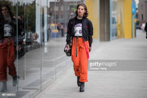 A guest wearing high waisted orange pants bomber jacket is seen during Tbilisi Fashion Week Spring/Summer 2018 on October 28 2017 in Tbilisi Georgia