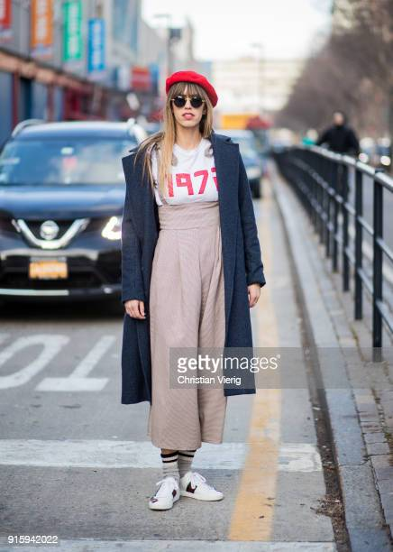 A guest wearing high waisted pants red beret seen outside Creatures of Comfort on February 8 2018 in New York City