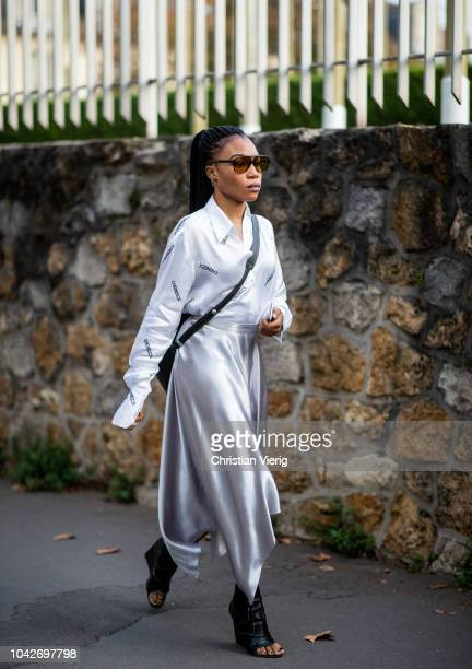 A guest wearing Iceberg blouse silver skirt is seen outside Loewe during Paris Fashion Week Womenswear Spring/Summer 2019 on September 28 2018 in...