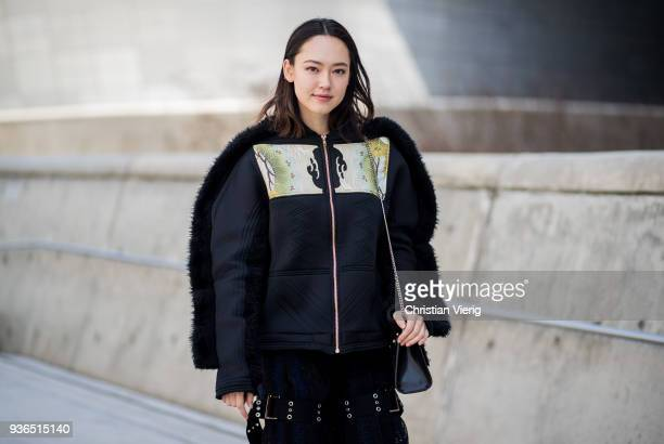 A guest wearing jacket transparent black flared pants is seen at the Hera Seoul Fashion Week 2018 F/W at Dongdaemun Design Plaza on March 22 2018 in...