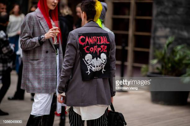 A guest wearing jacket with patch is seen during MercedesBenz Tbilisi Fashion Week on November 1 2018 in Tbilisi Georgia