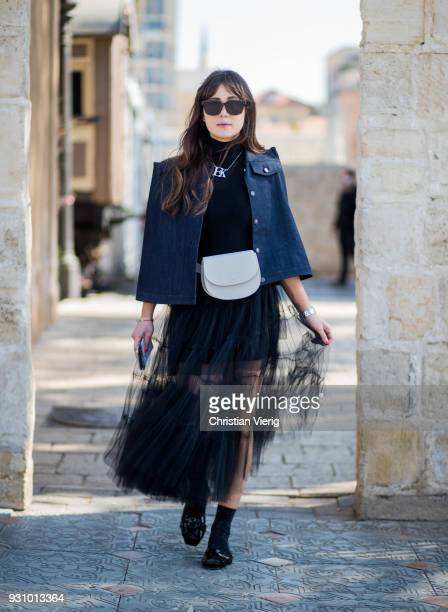 A guest wearing jacket with strong shoulder belt bag sheer dress is seen during Tel Aviv Fashion Week on March 12 2018 in Tel Aviv Israel
