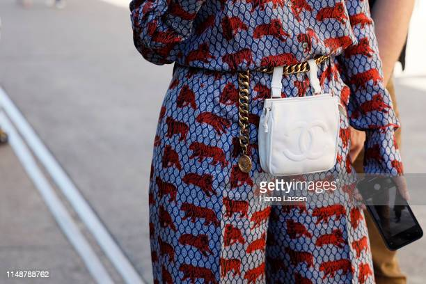 A guest wearing JCrew jumpsuit white Chanel belt bag Off White shoes at MercedesBenz Fashion Week Resort 20 Collections on May 13 2019 in Sydney...