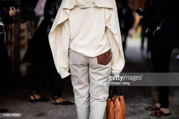 A guest wearing JW Anderson pants beige knit is seen outside Natasha Zinko during London Fashion Week September 2018 on September 18 2018 in London...