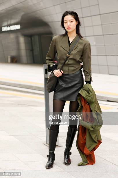 Guest wearing khaki jacket leather skirt and knee high boots is seen at the Hera Seoul Fashion Week 2019 F/W at Dongdaemun Design Plaza at Dongdaemun...