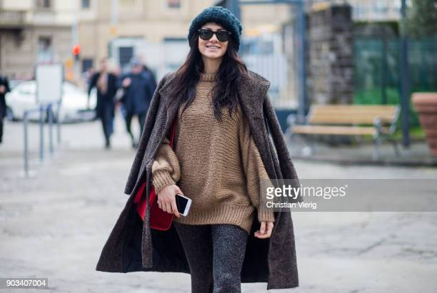 A guest wearing knit wool hat is seen during the 93 Pitti Immagine Uomo at Fortezza Da Basso on January 10 2018 in Florence Italy