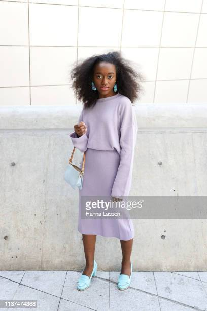 Guest wearing lavender knit jumper and skirt Louis Vuitton clutch and mint shoes is seen at the Hera Seoul Fashion Week 2019 F/W at Dongdaemun Design...