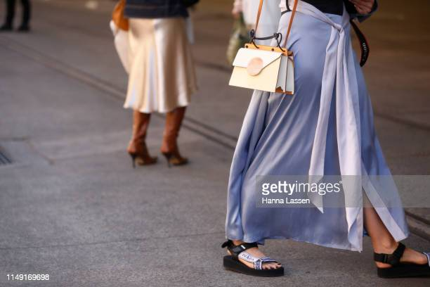 A guest wearing Leo and Lin dress and Prada shoes at MercedesBenz Fashion Week Resort 20 Collections on May 15 2019 in Sydney Australia