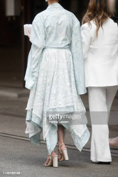 A guest wearing Leo and Lin dress at MercedesBenz Fashion Week Resort 20 Collections on May 15 2019 in Sydney Australia