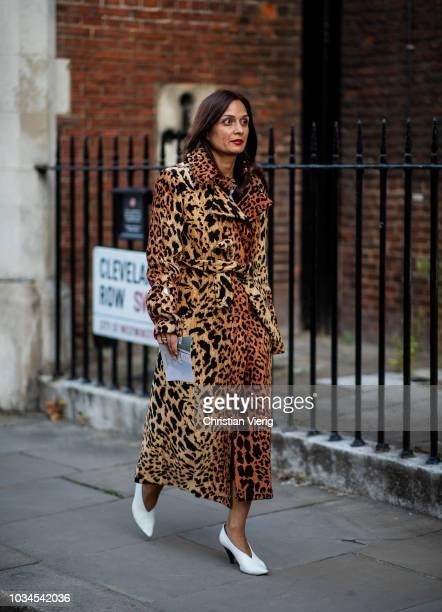 A guest wearing leopard coat is seen outside Simone Rocha during London Fashion Week September 2018 on September 16 2018 in London England