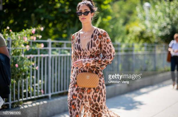 A guest wearing leopard dress Chanel bag is seen outside Noon By Noor during New York Fashion Week Spring/Summer 2019 on September 6 2018 in New York...