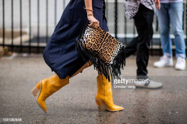 A guest wearing leopard print bag is seen outside 31 Phillip Lim during New York Fashion Week Spring/Summer 2019 on September 10 2018 in New York City
