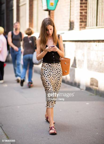 A guest wearing leopard print skirt is seen outside Y/PROJECT on day two of Paris Fashion Week Menswear SS19 on June 20 2018 in Paris France