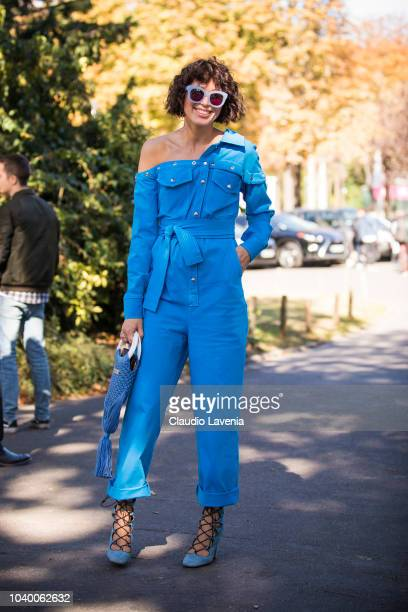 Guest wearing light blue jumpsuit and sunglasses is seen after the Jour/ne show on September 25 2018 in Paris France