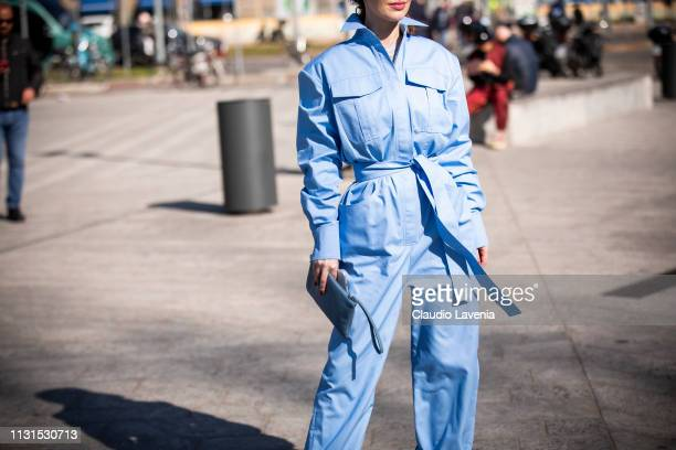 Guest wearing light blue jumpsuit is seen outside Sportmax on Day 3 Milan Fashion Week Autumn/Winter 2019/20 on February 22 2019 in Milan Italy