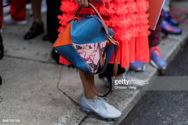 A guest wearing Loewe bag seen in the streets of Manhattan outside Marc Jacobs during New York Fashion Week on September 13 2017 in New York City