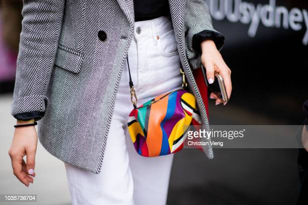 A guest wearing Loewe elephant bag is seen outside Natasha Zinko during London Fashion Week September 2018 on September 18 2018 in London England