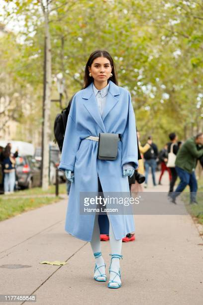 A guest wearing Loewe jacket and bag outside Loewe Paris Fashion Week Womenswear Spring Summer 2020 on September 27 2019 in Paris France