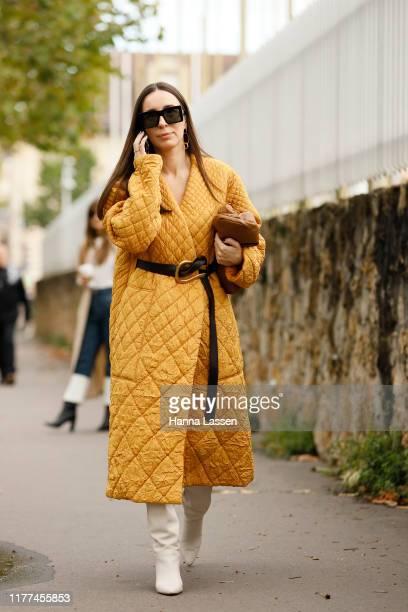 Guest wearing Loewe jacket and bag outside Loewe Paris Fashion Week - Womenswear Spring Summer 2020 on September 27, 2019 in Paris, France.
