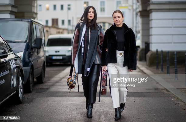 A guest wearing Loewe jacket Balenciaga scarf Fendi bag is seen outside Der Berliner Modesalon during the Berlin Fashion Week January 2018 on January...