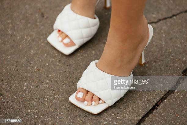 Guest wearing Loewe jacket, sunglasses and bag and Bottega Veneta mules outside Loewe Paris Fashion Week - Womenswear Spring Summer 2020 on September...