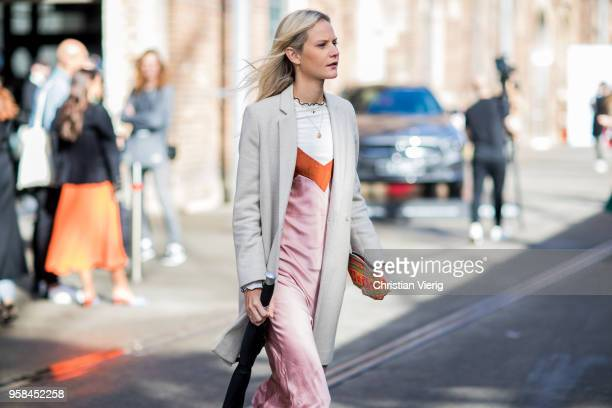 A guest wearing long creme white blazer pink satin dress during MercedesBenz Fashion Week Resort 19 Collections at Carriageworks on May 14 2018 in...