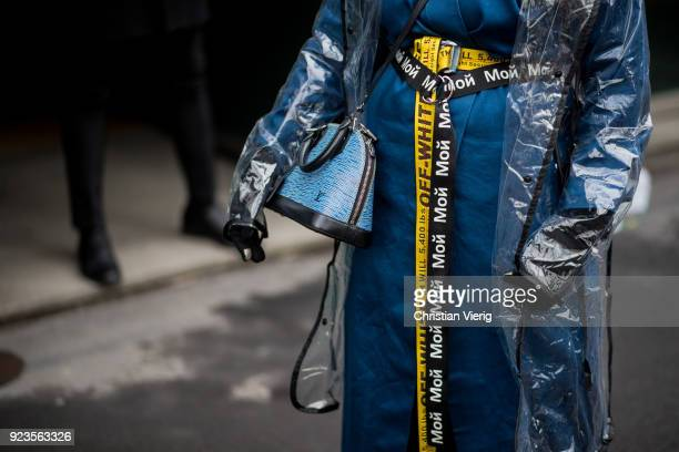 A guest wearing Louis Vuitton bag Off White belt seen outside Etro during Milan Fashion Week Fall/Winter 2018/19 on February 23 2018 in Milan Italy
