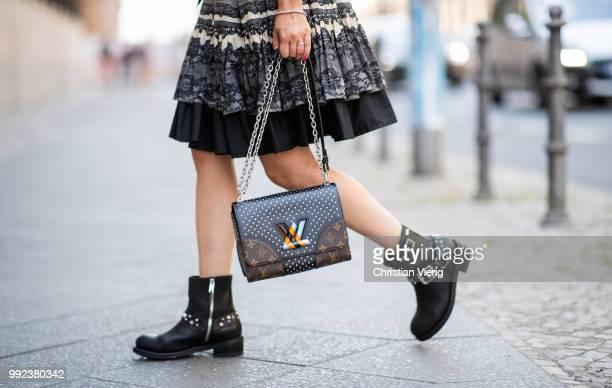 A guest wearing Louis Vuitton bag seen outside Lana Mueller during the Berlin Fashion Week July 2018 on July 5 2018 in Berlin Germany