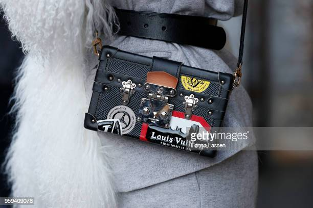 A guest wearing Louis Vuitton clutch and Chanel sneakers during MercedesBenz Fashion Week Resort 19 Collections at Carriageworks on May 17 2018 in...