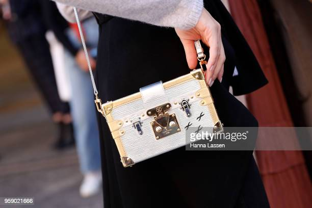 A guest wearing Louis Vuitton clutch during MercedesBenz Fashion Week Resort 19 Collections at Carriageworks on May 16 2018 in Sydney Australia
