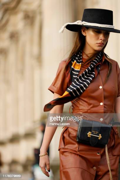 Guest wearing Louis Vuitton outfit outside Louis Vuitton show during Paris Fashion Week Womenswear Spring Summer 2020 on October 01, 2019 in Paris,...