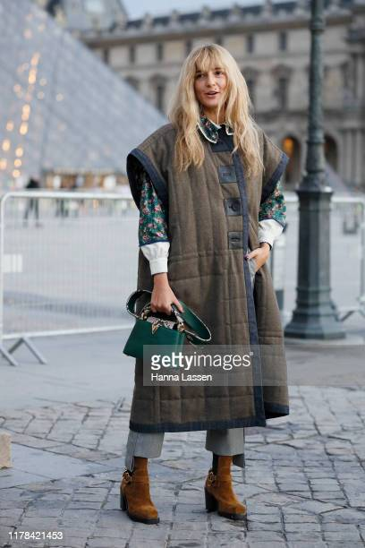 A guest wearing Louis Vuitton outside Louis Vuitton Paris Fashion Week Womenswear Spring Summer 2020 on October 01 2019 in Paris France