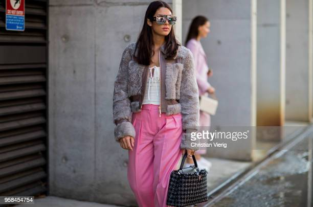 182fbef939cb1 ... Supreme Louis Vuitton sunglasses white Dior cropped top red lumberjack  plaid pants is. ED. Editorial use only. A guest wearing Louis Vuitton  sneakers ...