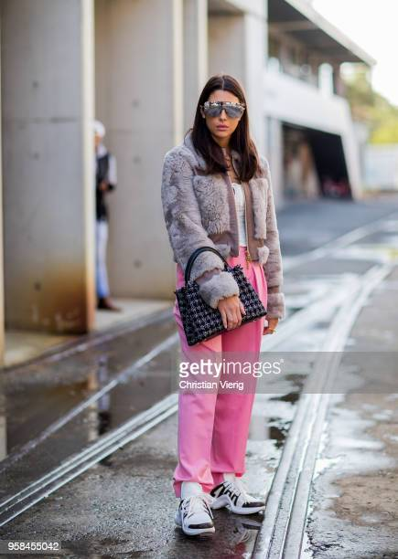 00d3a5ba1b201 A guest wearing Louis Vuitton sneakers Prada bag pink pants laced top  jacket mirrored sunglasses during