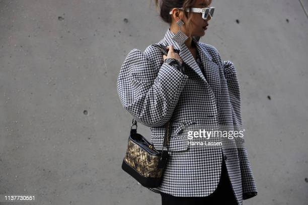 Guest wearing Louis Vuitton sunglasses puff shoulder jacket and Chanel bag is seen at the Hera Seoul Fashion Week 2019 F/W at Dongdaemun Design Plaza...