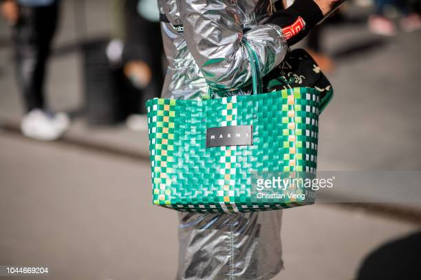 A guest wearing Marni bag is seen outside Giambattista Valli during Paris Fashion Week Womenswear Spring/Summer 2019 on October 1 2018 in Paris France