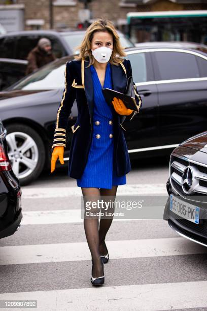 A guest wearing mask is seen outside Balmain fashion show on February 28 2020 in Paris France