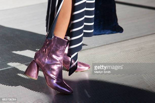 Guest wearing metallic boots during MercedesBenz Fashion Week Resort 18 Collections at Carriageworks on May 16 2017 in Sydney Australia