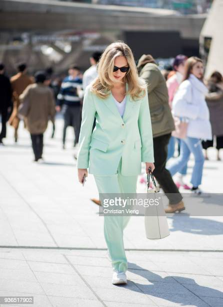 A guest wearing mint green suit white bag is seen at the Hera Seoul Fashion Week 2018 F/W at Dongdaemun Design Plaza on March 22 2018 in Seoul South...